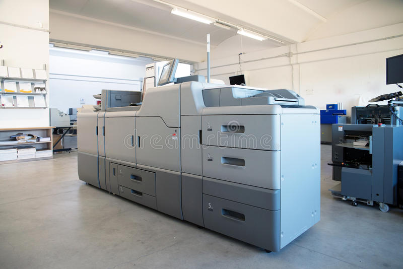 Print Shop - Digital press printing machine stock images