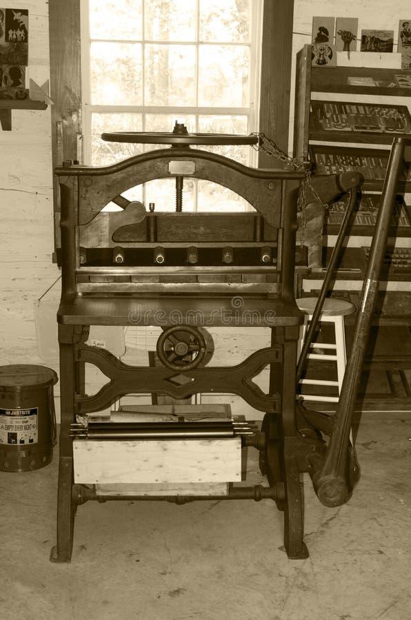 Print shop paper cutter sepia stock photos