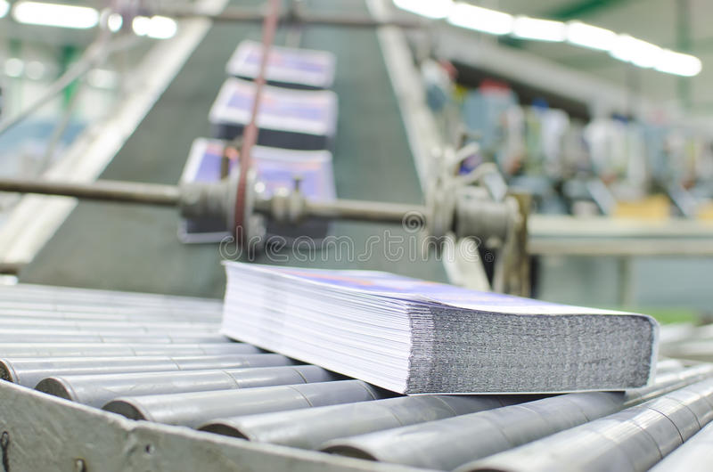 Print shop (press printing) - Finishing line stock photos