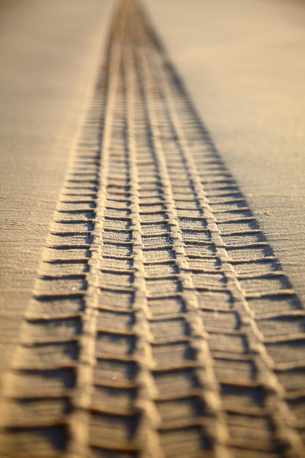 Print Of A Tyre Tread On A Sand Stock Photos