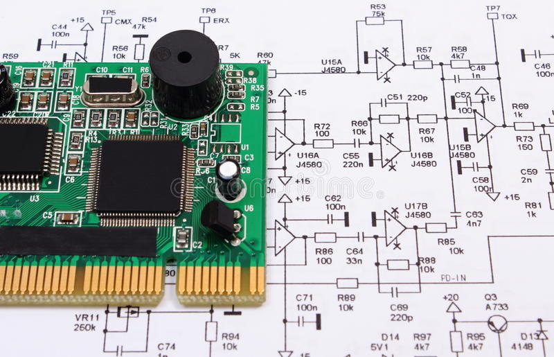 Printed Circuit Board Lying On Diagram Of Electronics, Technology ...