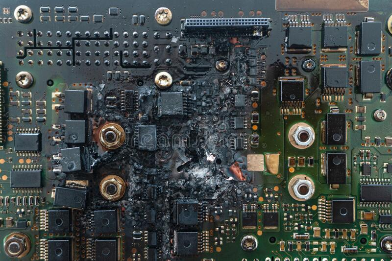Printed circuit board or PCB with electronic components severe damaged by electrical short circuit stock photos