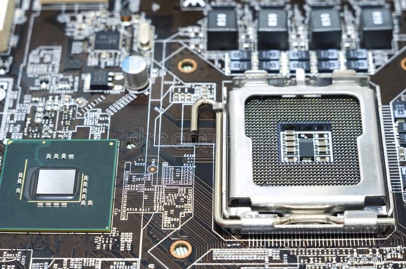 Printed computer motherboard with microcircuit, close up. Processor and detail macro main megabyte communication and board byte capacitor stock photography