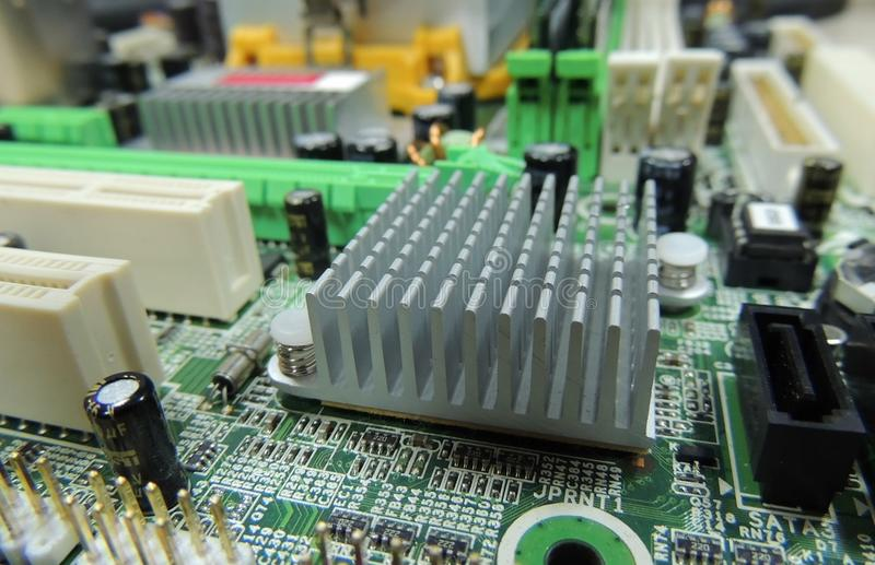 Printed electronic board with soldered radio components macro shot royalty free stock photos