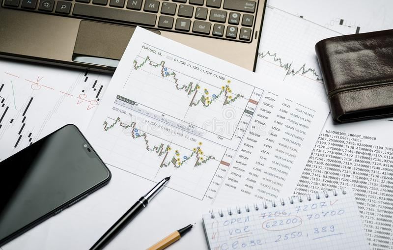 Printed financial charts of currencies, Forex, broker`s workplace stock images