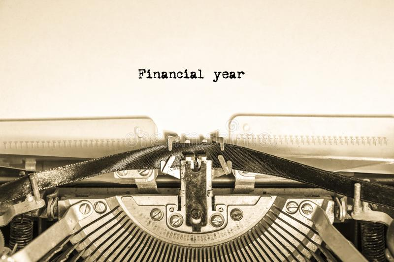 Printed inscription Financial year on a vintage typewriter on a piece of paper. Business, finance royalty free stock photo