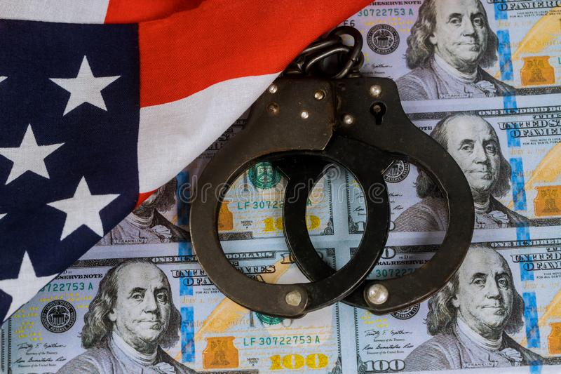 Printed US dollars banknotes, fake money currency counterfeiting. And police handcuffs, forgery, magnifying, glass, crime, illegal, cash, wealth, bill, white stock image