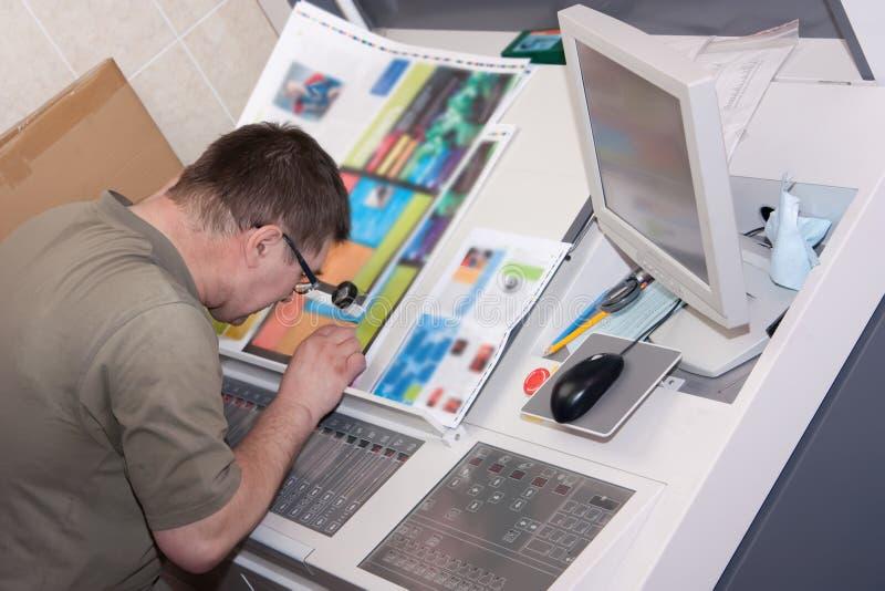 Printer checking a print run stock photos