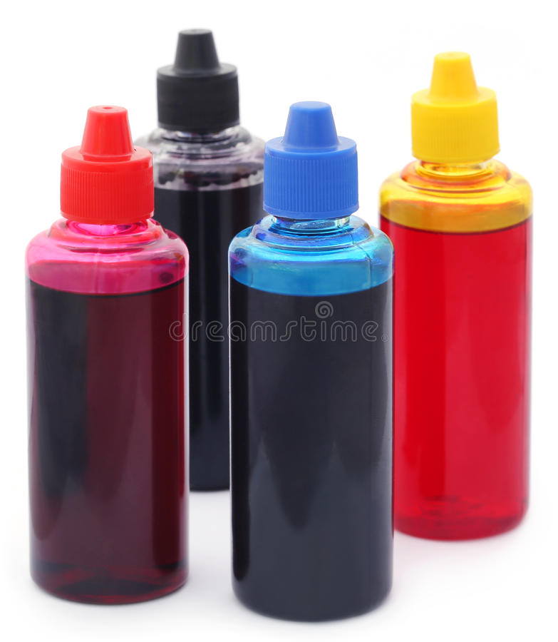 Printer ink bottles. Over white background stock photos