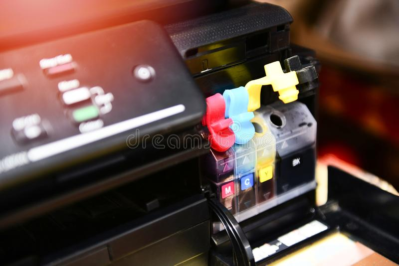 Printer ink tank for refill at office / Close up printer cartridge inkjet of color black CMYK and repair fix the problem concept royalty free stock photos