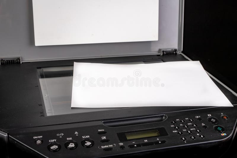 Printer with the option of copying on a dark table. Multifunction device intended for home use stock photos