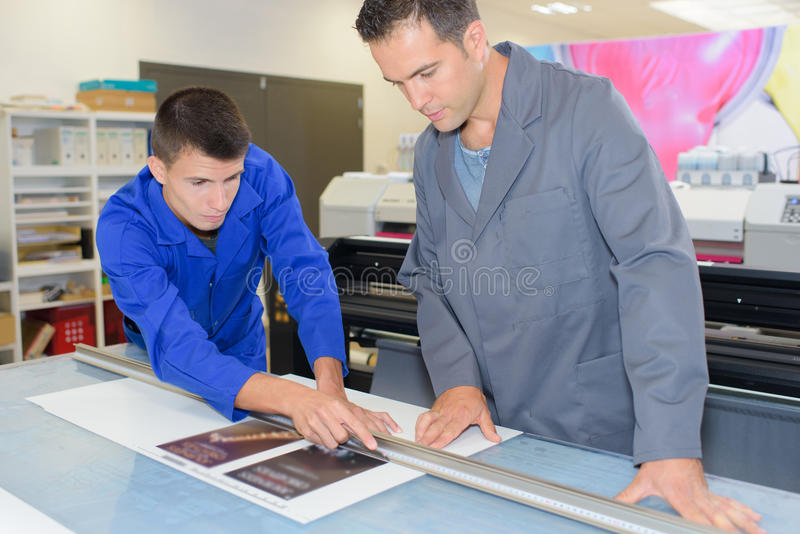Printing apprentice learning technique royalty free stock photography