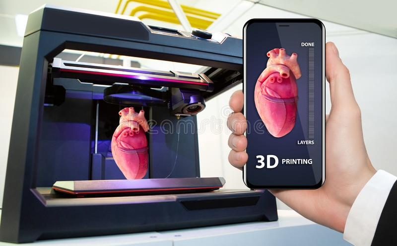 Printing human organs in a 3D printer. Hand with phone. Application for printing human organs in a 3D printer stock photos