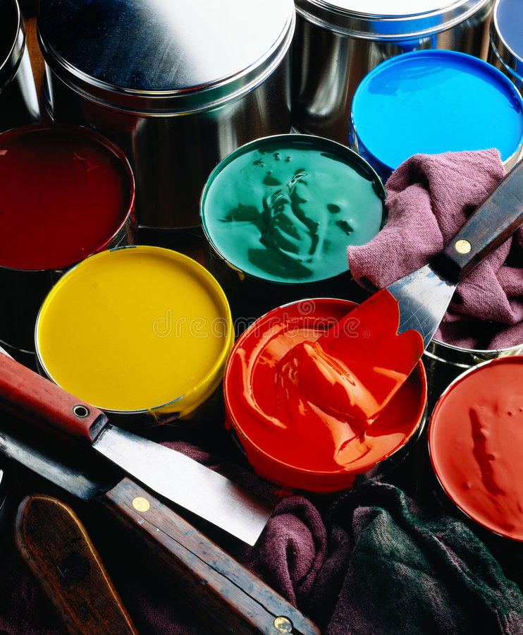 Printing inks. Cans of printing inks with ink knives and wipers