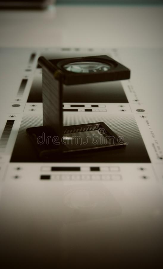 Printing magnifying glass, loupe on the test royalty free stock image