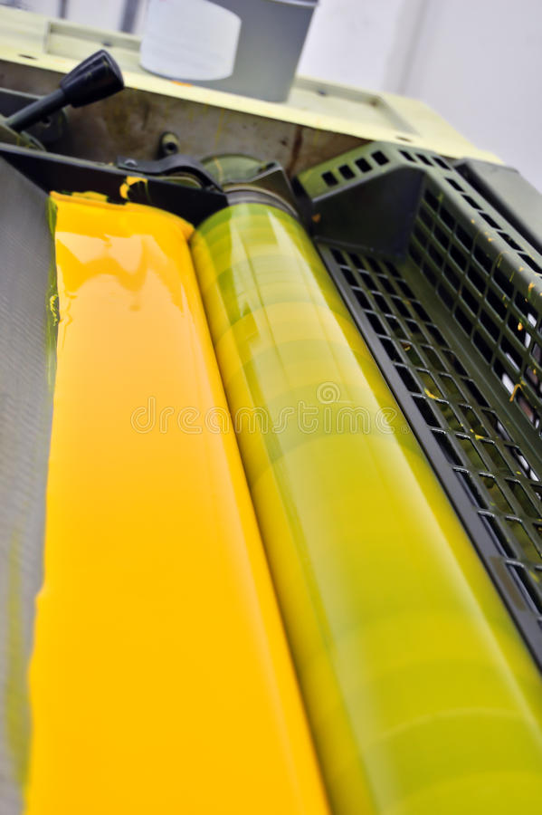Printing press yellow paint stock photo