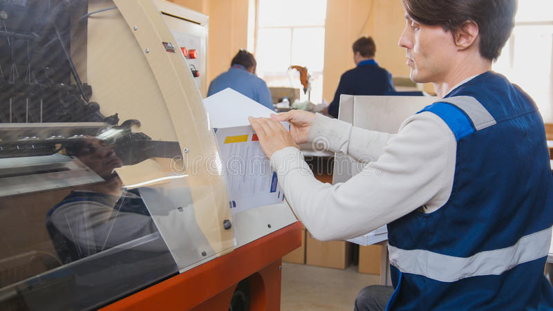 Printing Process on polygraph industry - magazines on the conveyor belt royalty free stock image