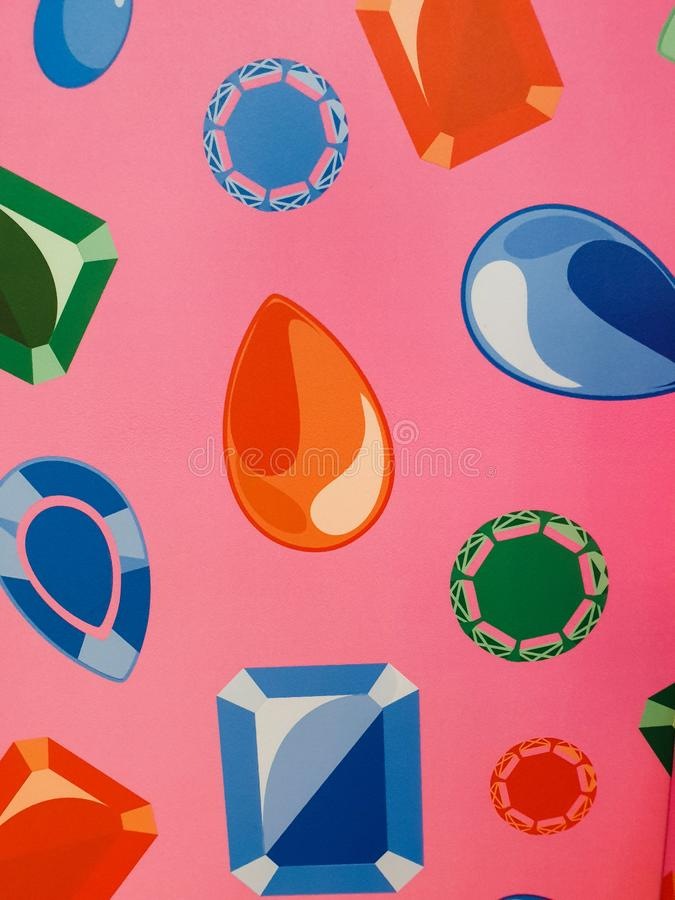 Free Printings Of Colorful Diamond Shaped Embellishments On Pink Wallpaper Background Stock Photos - 165516443