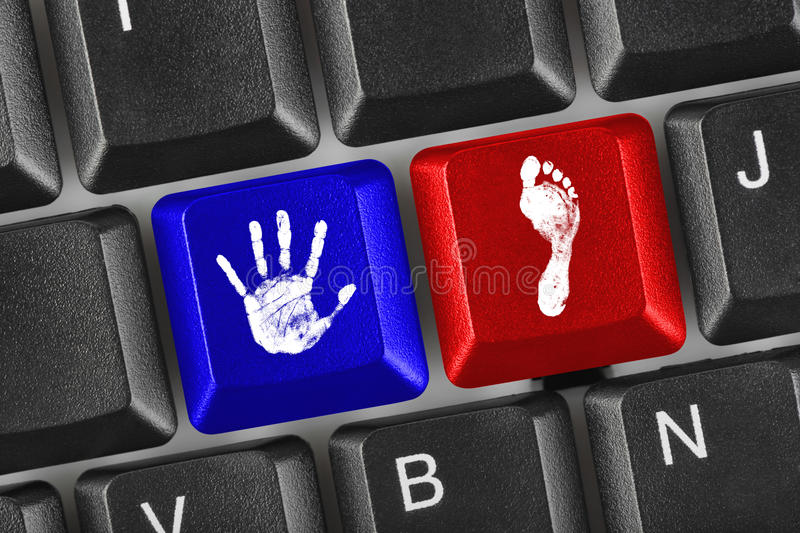 Download Printout Of Hand And Foot On Computer Keys Stock Photo - Image: 10837704
