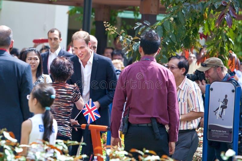 Prinz William, das seine wohlen wishers, Singapur-Sept. 12 2012 trifft lizenzfreie stockfotografie
