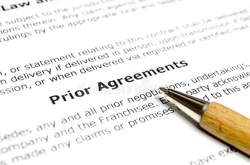 Prior agreements with wooden pen. Close up royalty free stock image