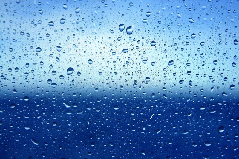Priorità bassa astratta di vetro del dropsoin dell'acqua blu fotografia stock