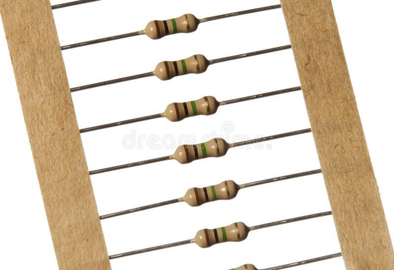 Priorità bassa bianca isolata fascia dei resistori di carbonio fotografia stock
