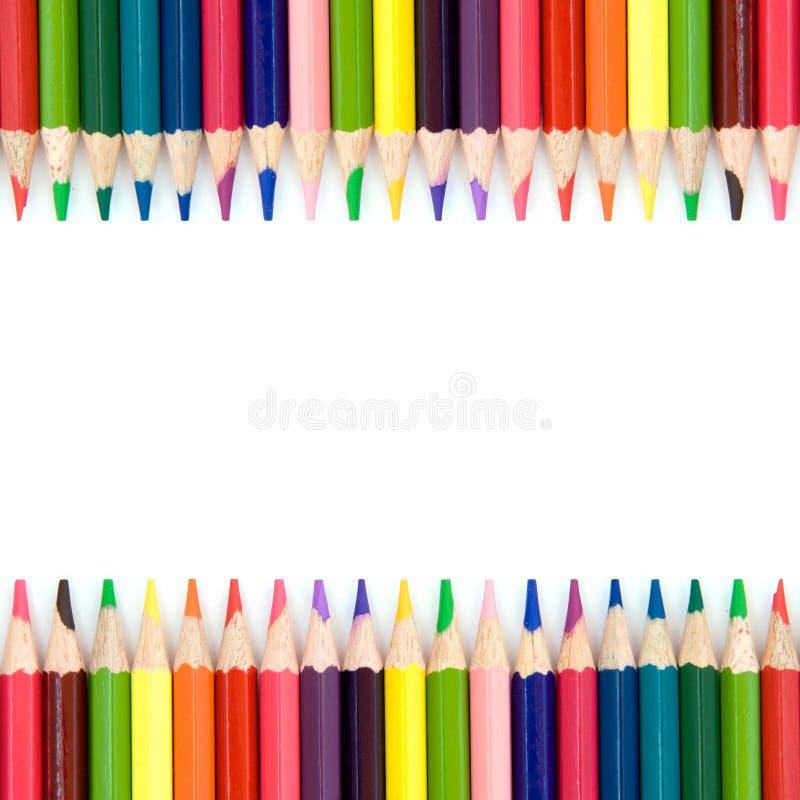Priorità bassa con le matite di colore immagine stock
