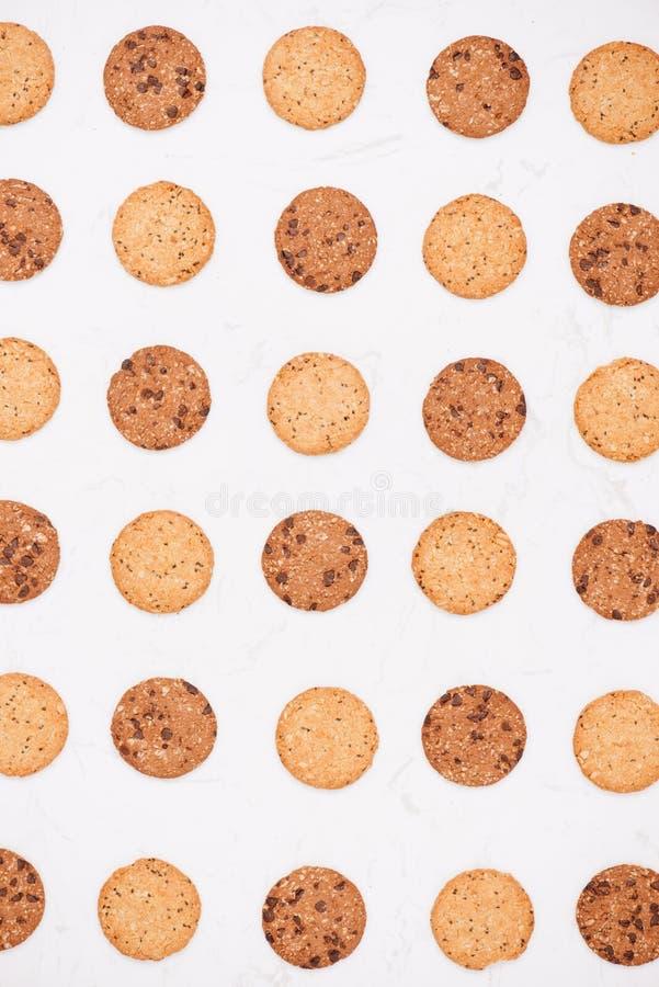 Priorità bassa dei biscotti Fondo di struttura dei biscotti di pepita di cioccolato immagini stock