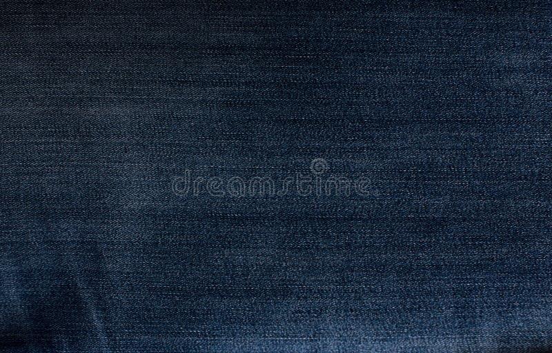 Priorità bassa dei jeans Primo piano di struttura dei jeans Blue jeans fotografia stock libera da diritti