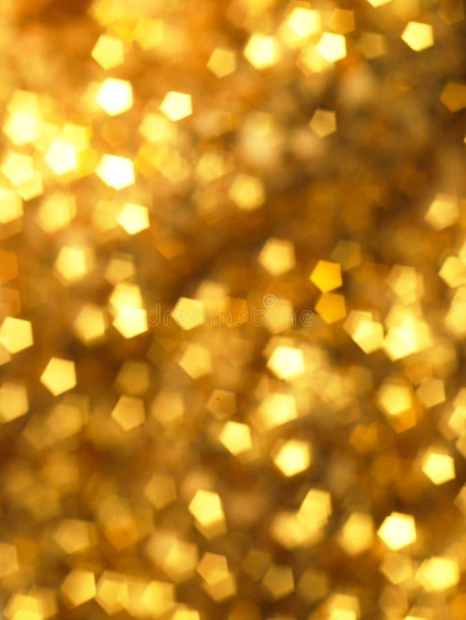 Priorità bassa del bokeh dell'oro fotografia stock libera da diritti