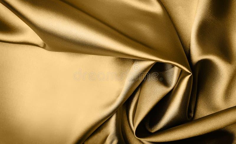 Priorità bassa del raso dell'oro immagine stock libera da diritti