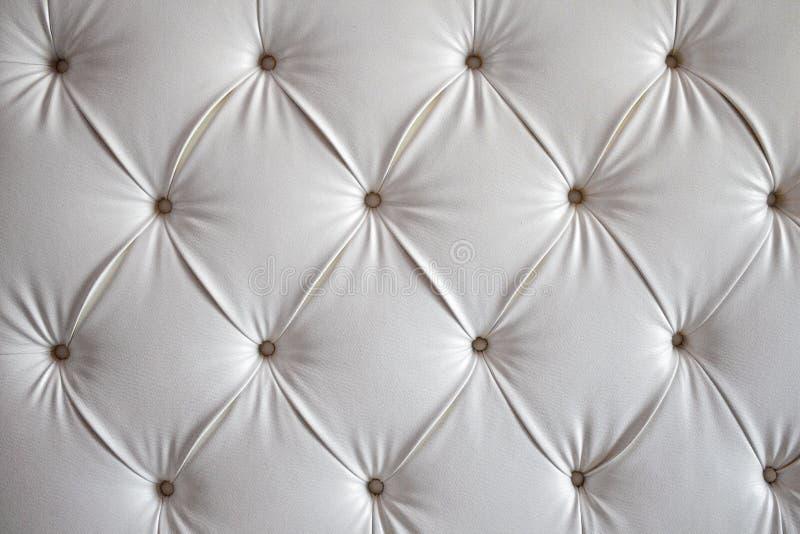 Priorità bassa del sofà del cuoio bianco fotografia stock