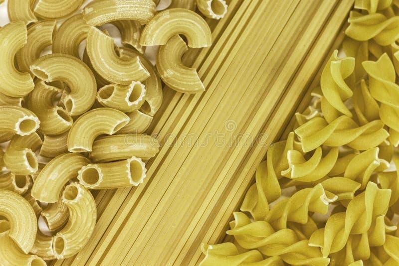 Priorità bassa della pasta spaghetti, tagliatelle messe fotografia stock