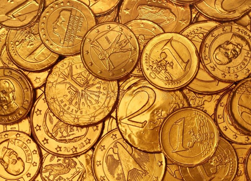Priorità bassa delle monete di oro del cioccolato immagini stock libere da diritti