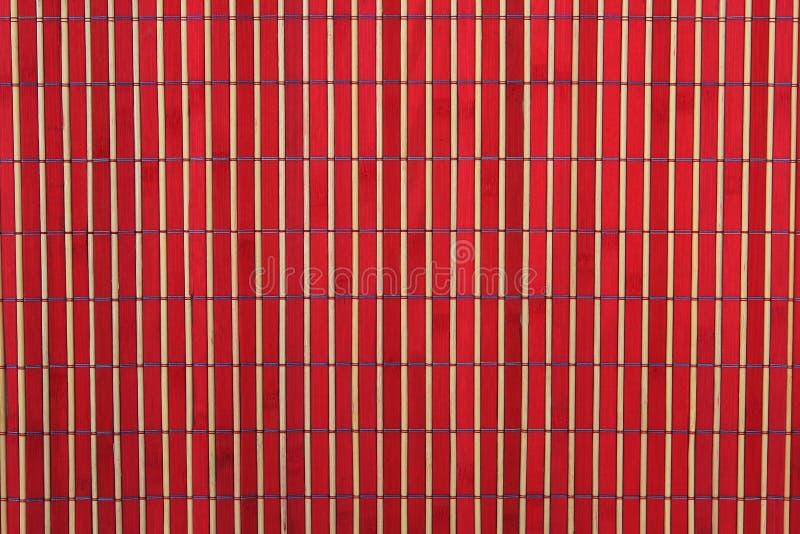 Priorità bassa di bambù rossa e di legno fotografia stock libera da diritti