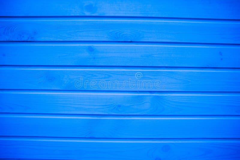 Priorità bassa di legno blu Il blu ha dipinto la struttura, il fondo e la carta da parati di legno Composizione orizzontale immagine stock