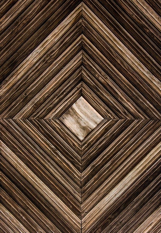 Priorità bassa di legno Fondo di legno geometrico Stecche di legno sotto forma di quadrato immagini stock