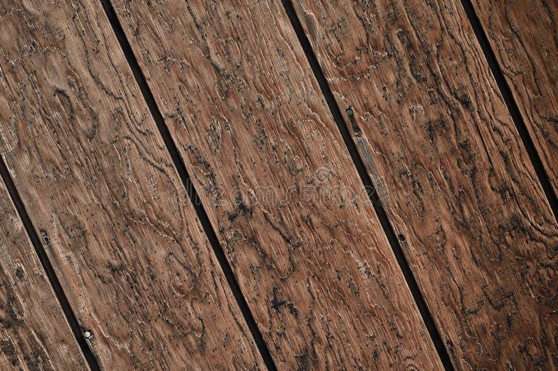 Priorità bassa di legno scura diagonale della plancia fotografia stock libera da diritti