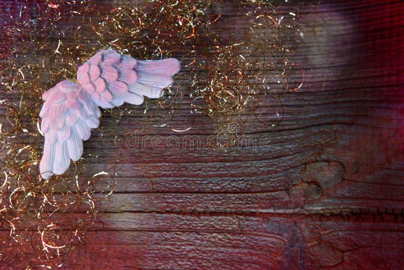 Priorità bassa di natale con le ali di angelo immagini stock libere da diritti