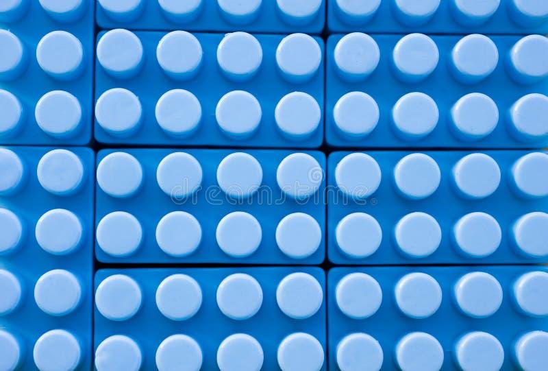 Priorità bassa di plastica blu della costruzione fotografia stock libera da diritti