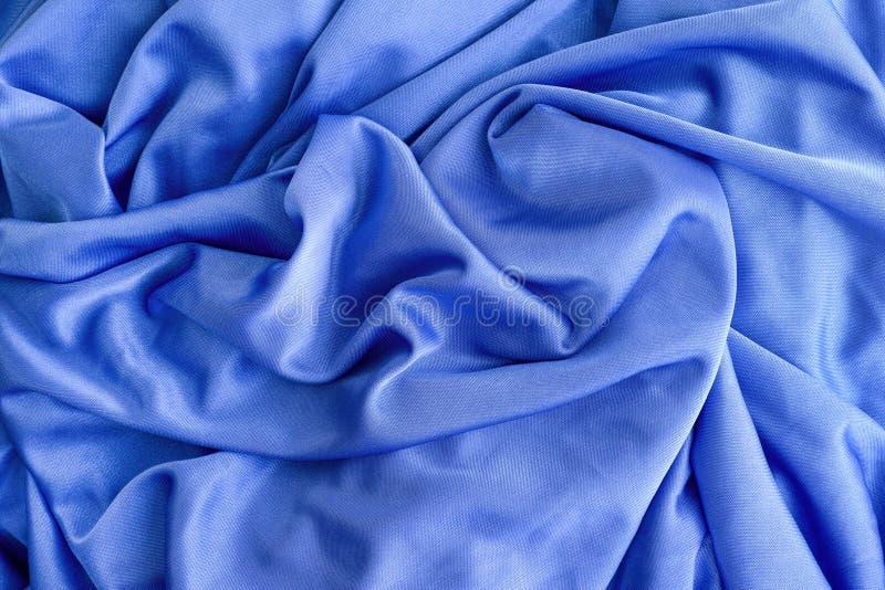 Priorità bassa di seta blu della tessile fotografie stock libere da diritti