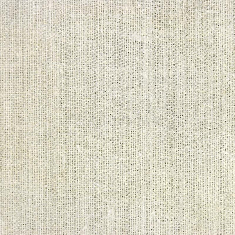 Priorità bassa di tela naturale di struttura della tela da imballaggio, tan fotografia stock
