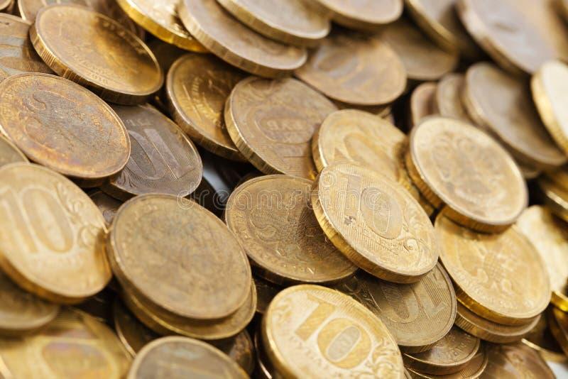 Priorità bassa dorata delle monete immagini stock