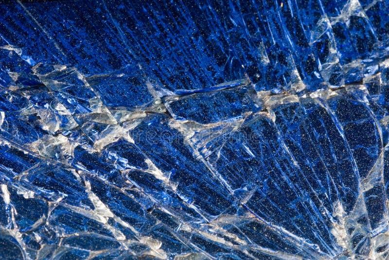 Priorità bassa - estratto di vetro blu rotto immagini stock libere da diritti