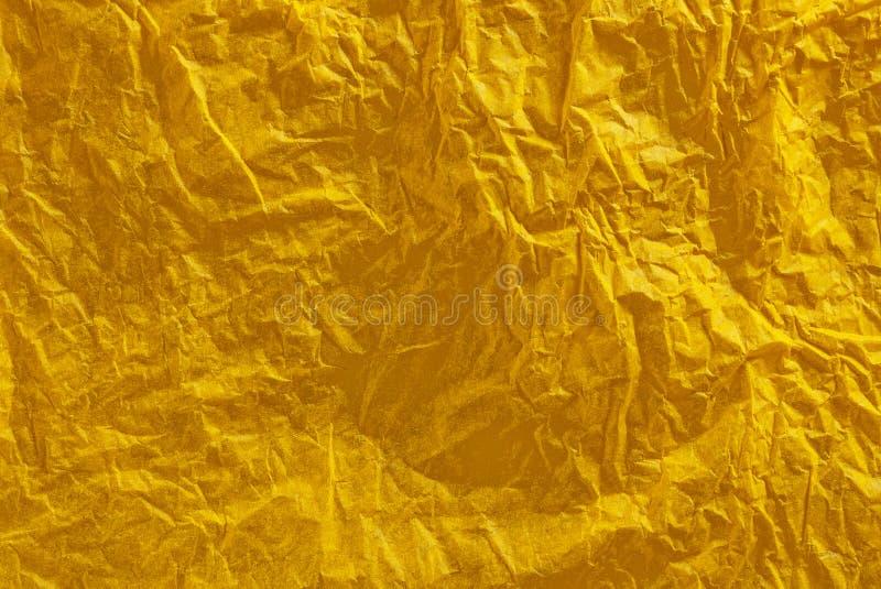 Priorità bassa gialla increspata della carta velina fotografia stock