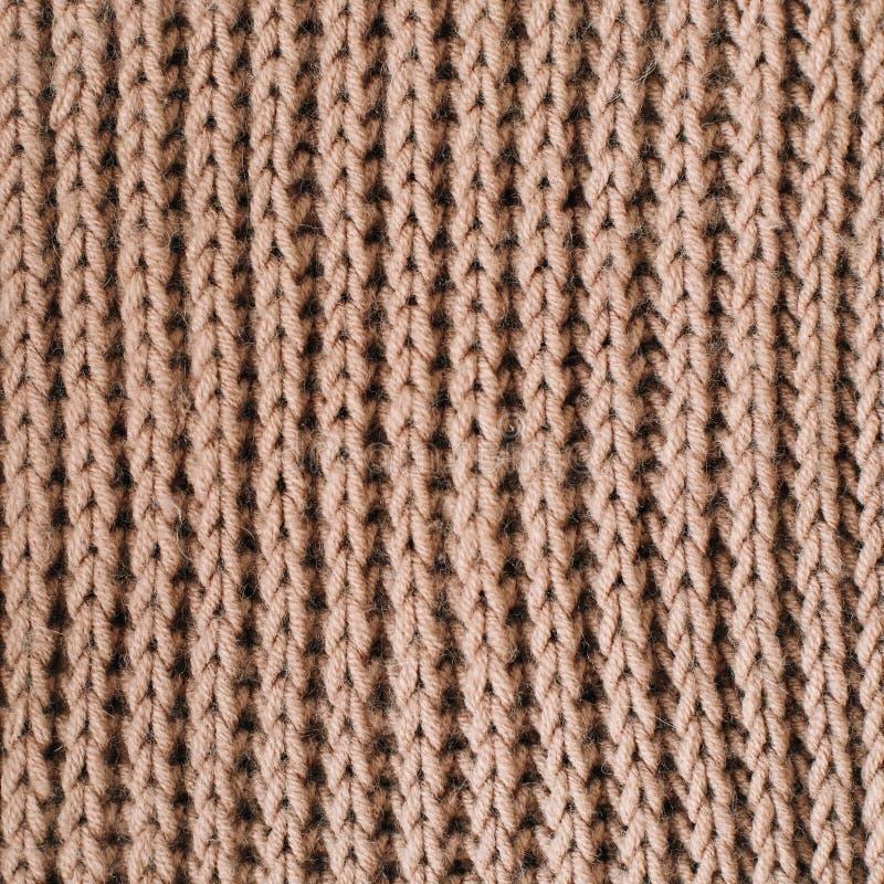 Priorità bassa lavorata a maglia Struttura tricottata tricottare modello di lana knitting Fondo Primo piano fotografie stock libere da diritti