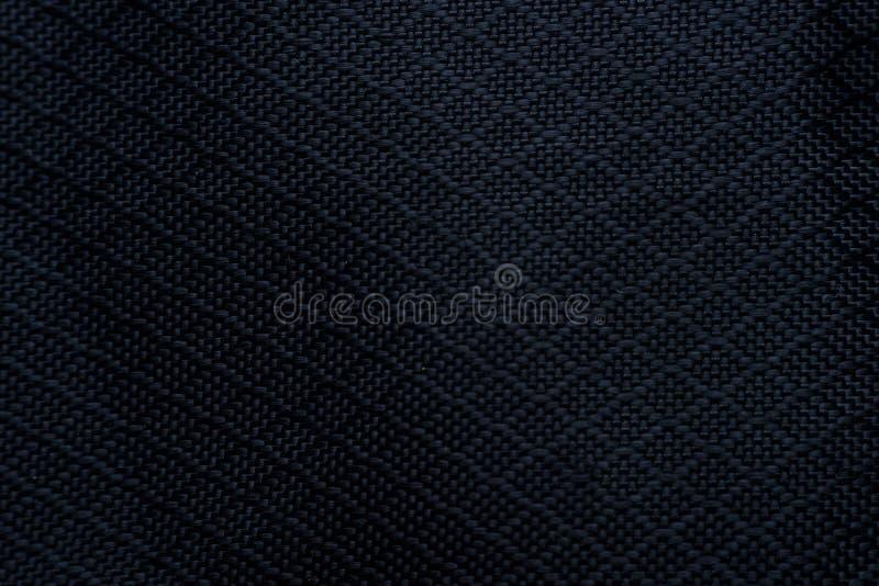 Priorità bassa nera di struttura del tessuto Dettaglio della materia tessile della tela fotografie stock
