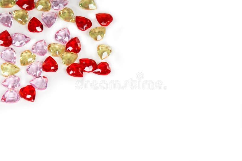 Priorità bassa romantica dei cuori rossi, gialli e dentellare immagine stock libera da diritti