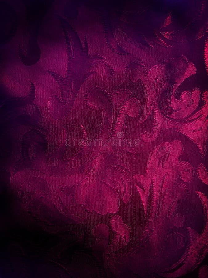 Priorità bassa viola scura del tessuto immagine stock